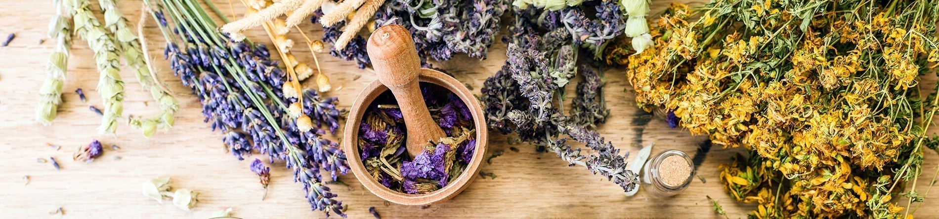Tranditional Remedies For Common Illnesses - Herbs on table